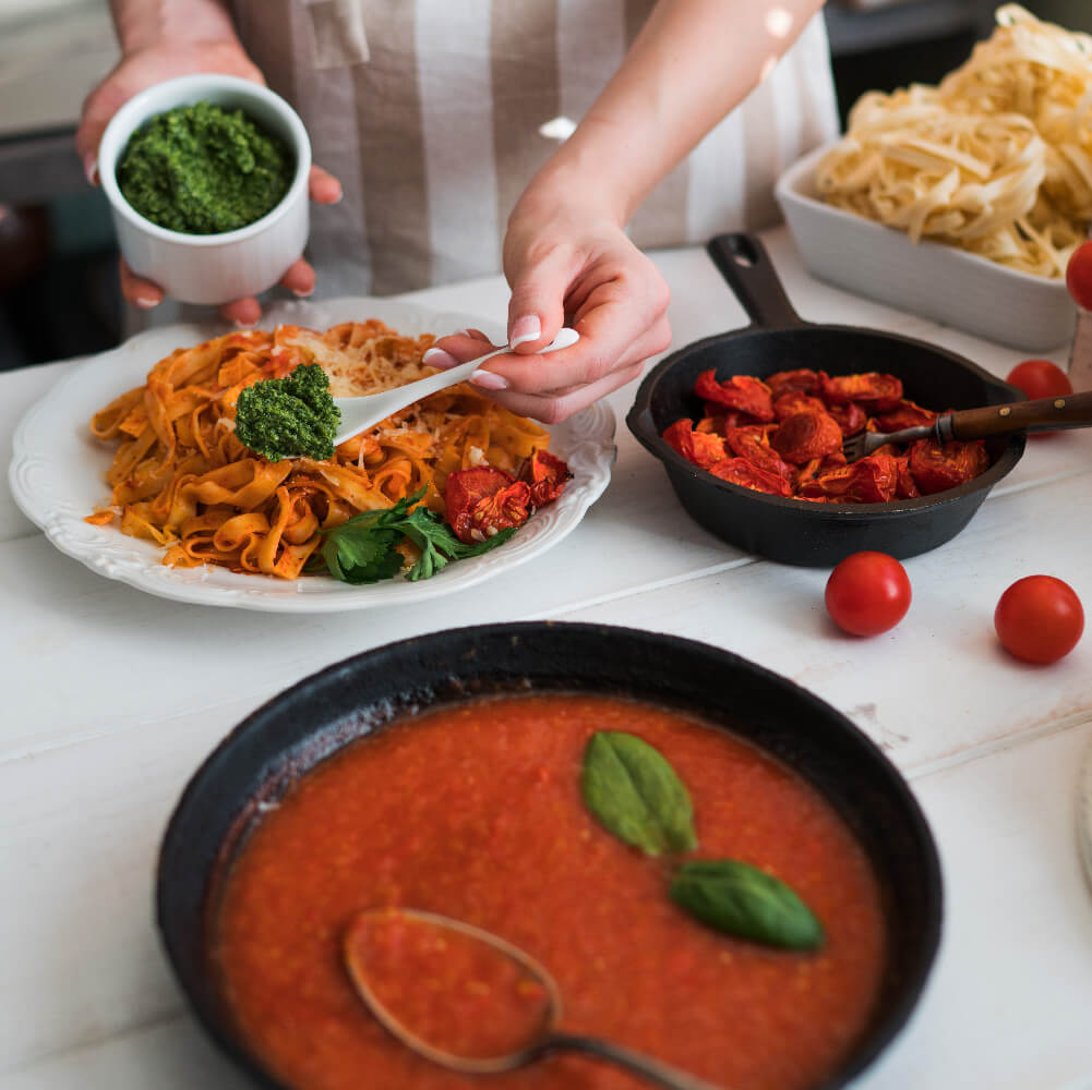 Weikfield red tangy salsa pasta sauce served in bowl
